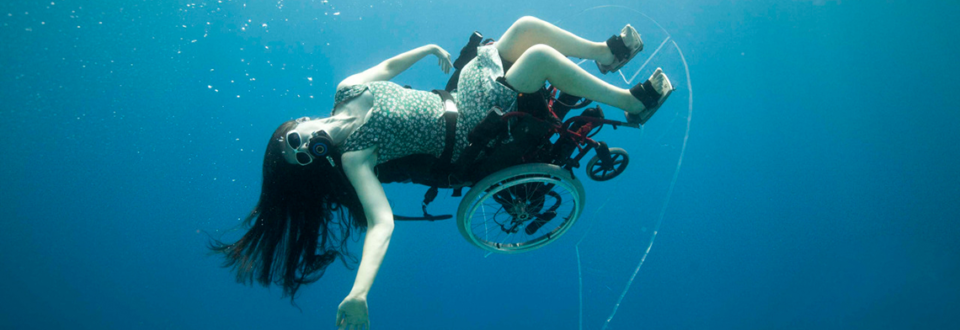 woman in a wheelchair swimming in the ocean
